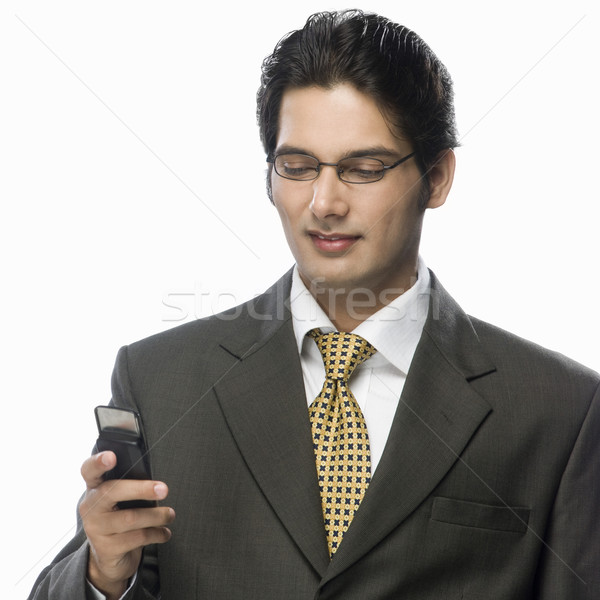 Zakenman naar mobiele telefoon telefoon man technologie Stockfoto © imagedb