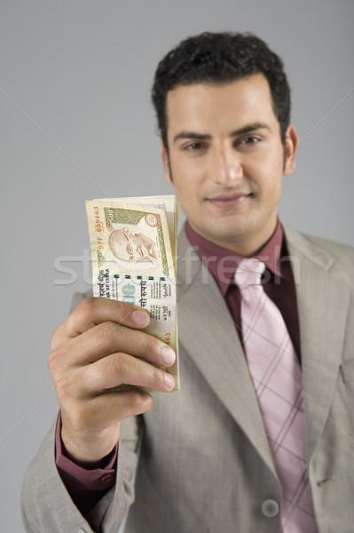 üzletember tart indiai öt száz siker Stock fotó © imagedb