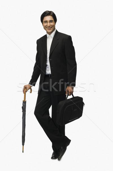 Retrato empresário sorridente pernas pasta Foto stock © imagedb