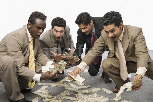 Cztery biznesmenów waluta zauważa Zdjęcia stock © imagedb