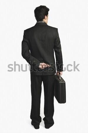 üzletember ujjak mögött hát üzlet férfi Stock fotó © imagedb
