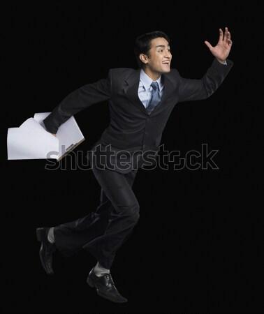 Empresário corrida clipboard negócio homem documento Foto stock © imagedb