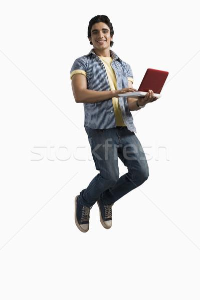 человека рабочих ноутбука прыжки интернет студент Сток-фото © imagedb