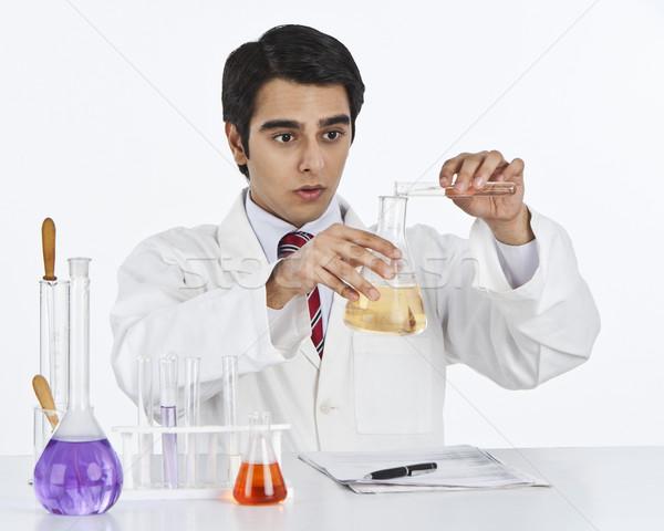 Male scientist doing scientific experiment in a laboratory Stock photo © imagedb