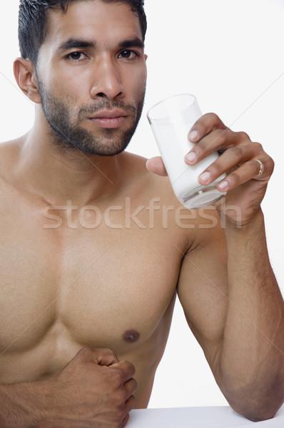 Portré macsó férfi iszik tej test Stock fotó © imagedb