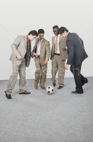 Cuatro empresarios jugando balón de fútbol negocios empresario Foto stock © imagedb