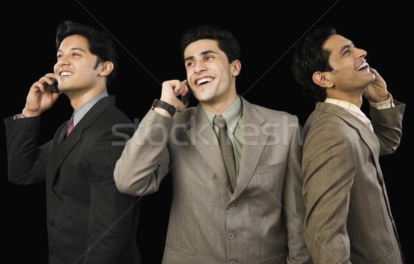 Három üzletemberek beszél mobiltelefonok üzlet technológia Stock fotó © imagedb