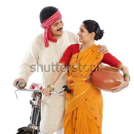 Couple celebrating Holi with colors and a drum Stock photo © imagedb