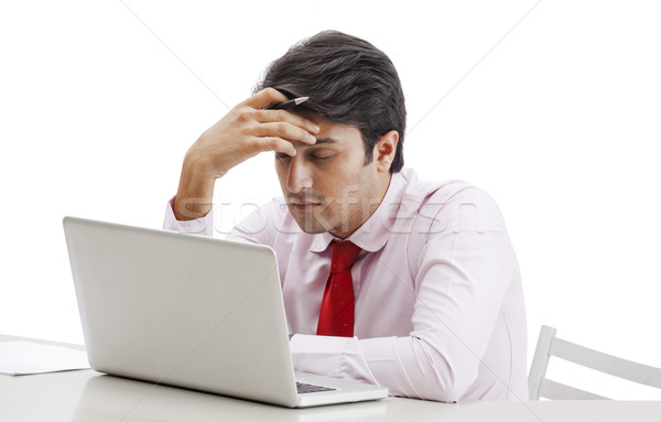 Businessman thinking in front of a laptop Stock photo © imagedb