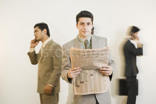 Imprenditore giornale colleghi business news Foto d'archivio © imagedb