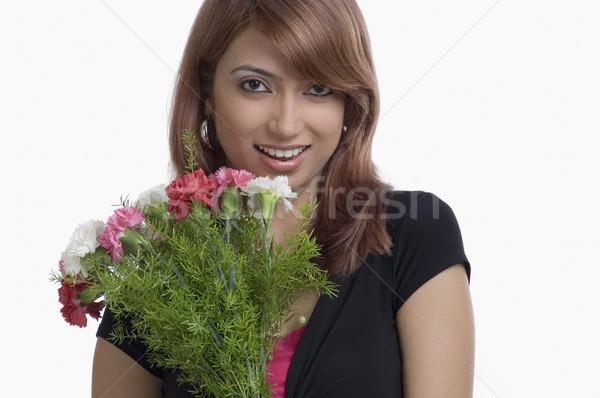 Portré nő tart virágcsokor szegfű virágok Stock fotó © imagedb
