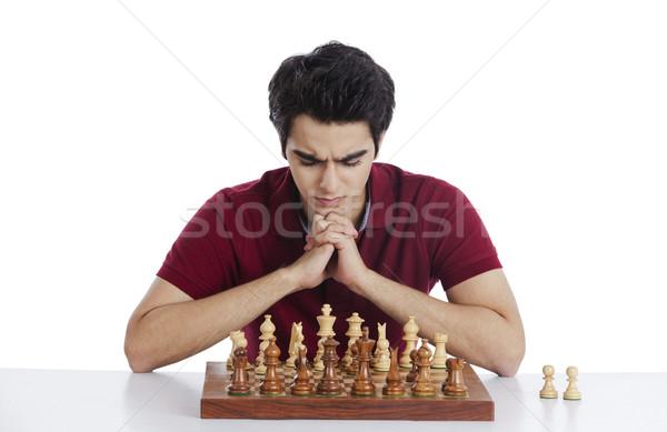 Férfi játszik sakk fiatal gondolkodik játék Stock fotó © imagedb