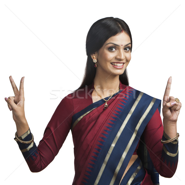 Traditionally Indian woman gesturing Stock photo © imagedb