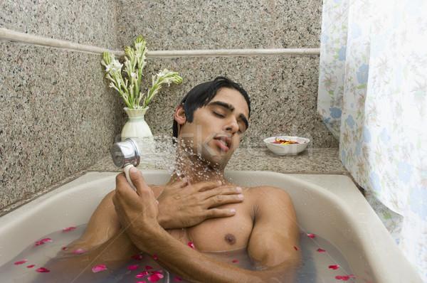 Homme douche baignoire rose détendre Photo stock © imagedb
