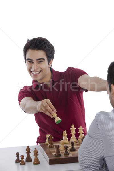 Férfi ünnepel siker nyerő sakk játék Stock fotó © imagedb