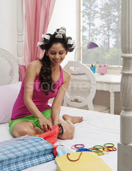 Woman choosing cloths and bangles Stock photo © imagedb