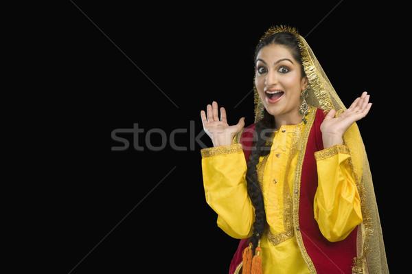 портрет женщину желтый платье улыбаясь Сток-фото © imagedb