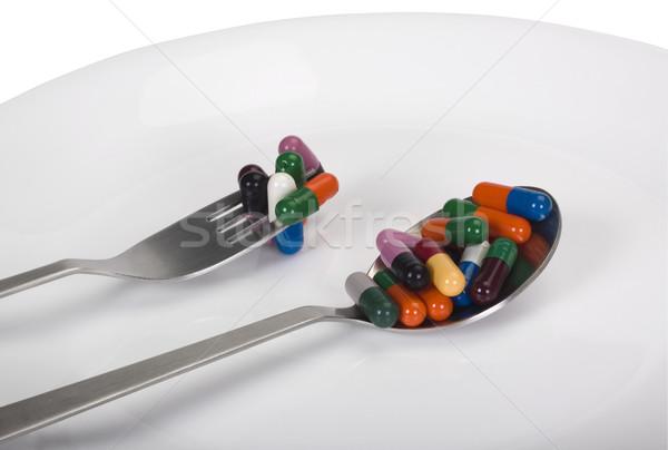 Kapsułki tablicy grupy widelec pigułki apteki Zdjęcia stock © imagedb