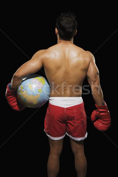 Hátsó nézet férfi boxoló tart földgömb férfi Stock fotó © imagedb