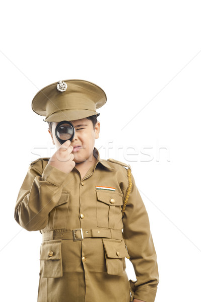 Close-up of a boy dressed as a police uniform looking through a  Stock photo © imagedb