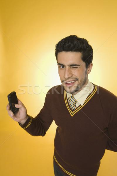 Empresário telefone móvel negócio homem retrato Foto stock © imagedb