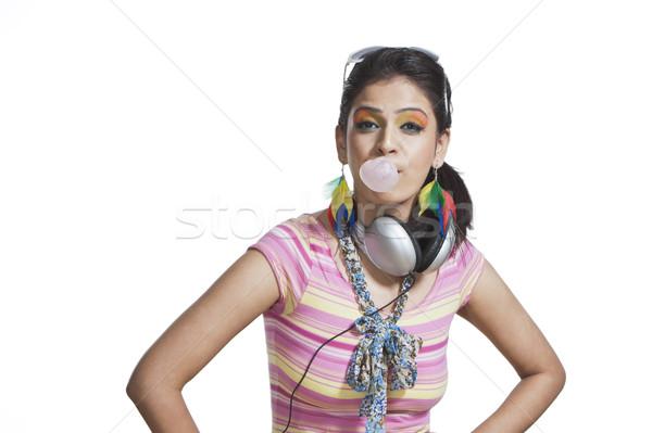 Beautiful young woman blowing bubble gum Stock photo © imagedb