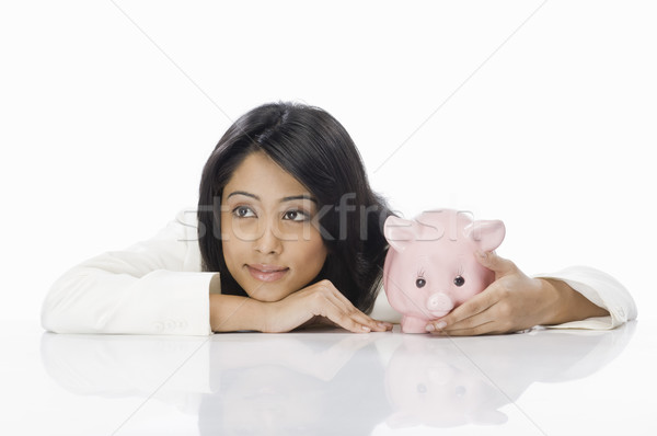 Zakenvrouw spaarvarken vrouw portret jonge manager Stockfoto © imagedb