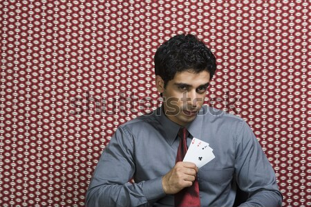 Portré férfi tart hazárdjáték sültkrumpli nyakkendő Stock fotó © imagedb