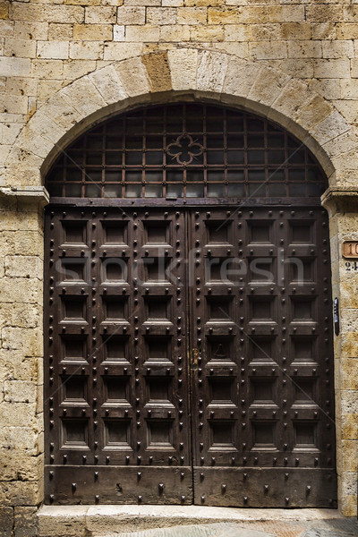 Stock photo: Closed door of a building in the medieval town of San Gimignano