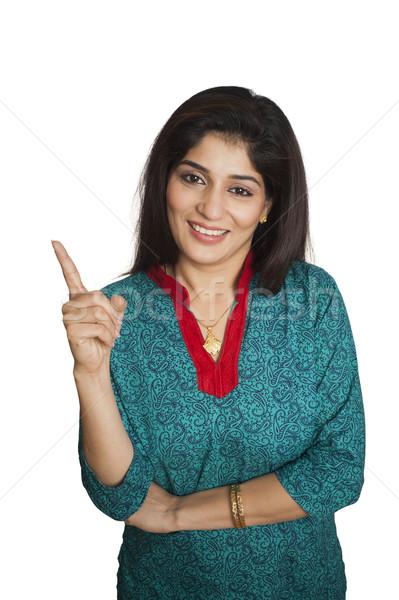 портрет счастливым женщину указывая Постоянный фотографии Сток-фото © imagedb