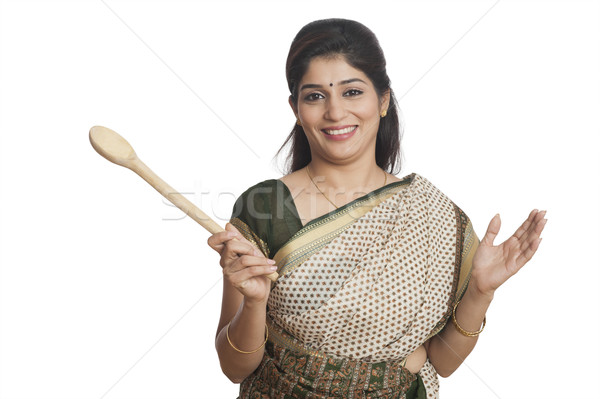 Portrait of a woman holding Wooden ladle Stock photo © imagedb
