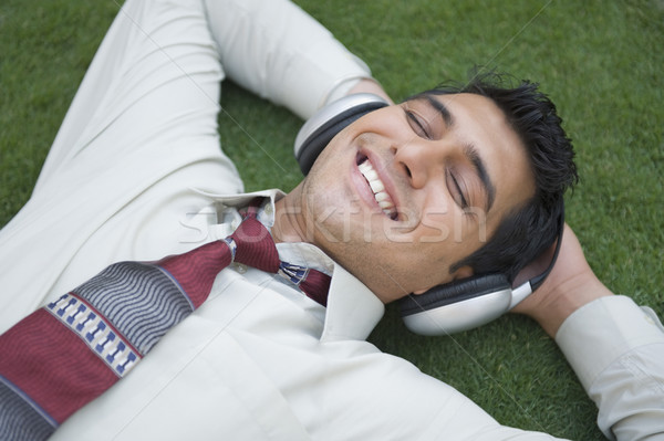 бизнесмен улыбаясь улыбка человека волос Сток-фото © imagedb