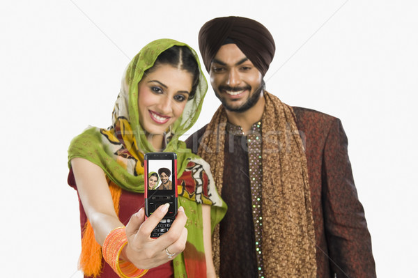 Sikh paar foto mobiele telefoon technologie Stockfoto © imagedb