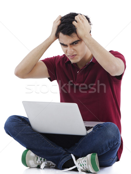 Man tearing his hair out while using a laptop Stock photo © imagedb