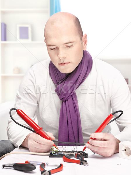 man doing minor repair at home Stock photo © imarin