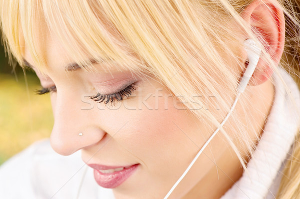 Close up of a woman with headphones Stock photo © imarin