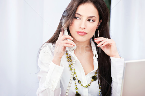 Pretty business woman having a telephone call Stock photo © imarin