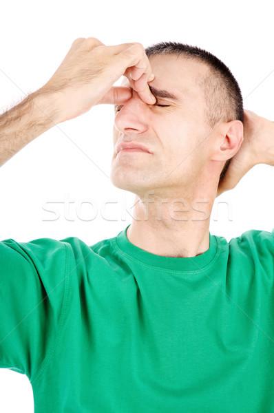 Férfi migrén támadás izolált fehér arc Stock fotó © imarin