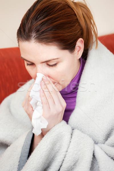 woman sneezing in the handkerchief Stock photo © imarin