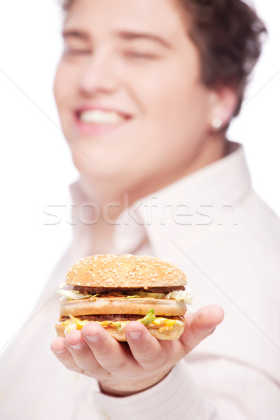 Hamburguesa mano jóvenes rechoncho hombre aislado Foto stock © imarin