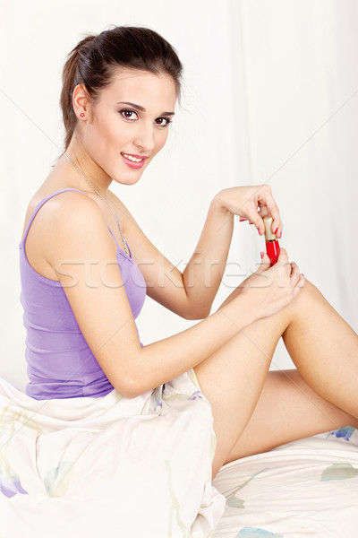 Woman applying nail polish Stock photo © imarin