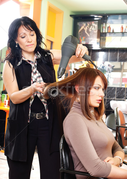 Hairdresser and the girl Stock photo © imarin