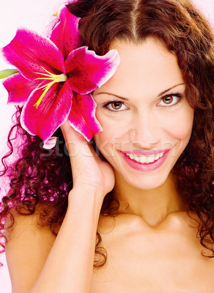 woman with flower in her curl hair Stock photo © imarin
