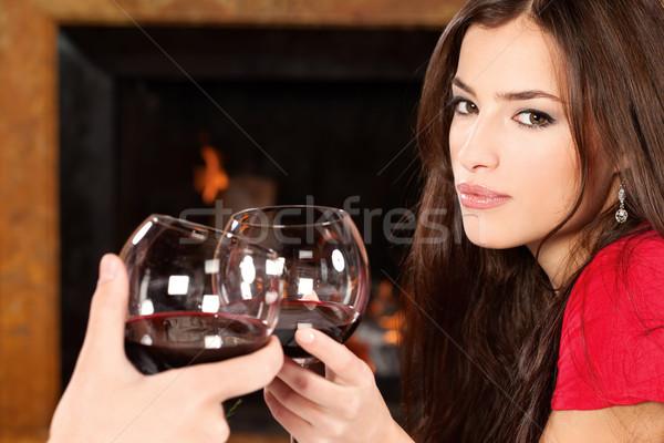 женщину кто-то красивая женщина камин стекла Сток-фото © imarin
