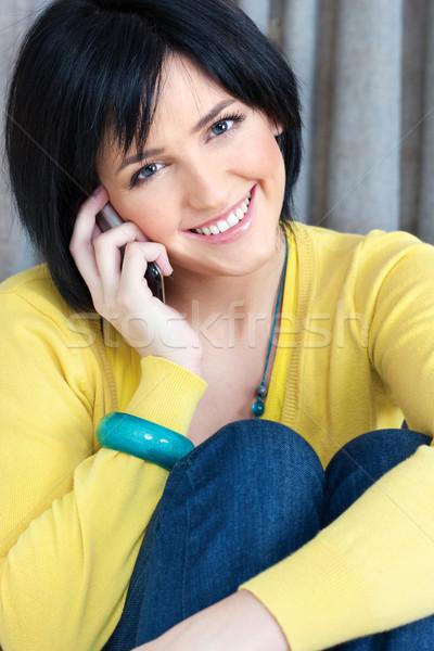 girl using mobile phone at home Stock photo © imarin