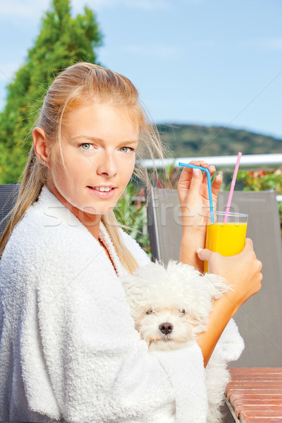 Woman drinking morning juice on terrace with her dog Stock photo © imarin