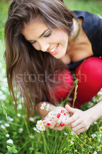 Stock photo: woman in park gather spring flowers