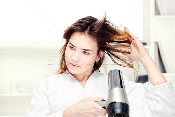 girl drying her hair at home Stock photo © imarin