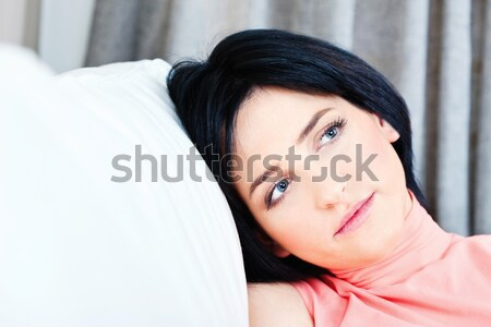 woman on white sofa at home Stock photo © imarin