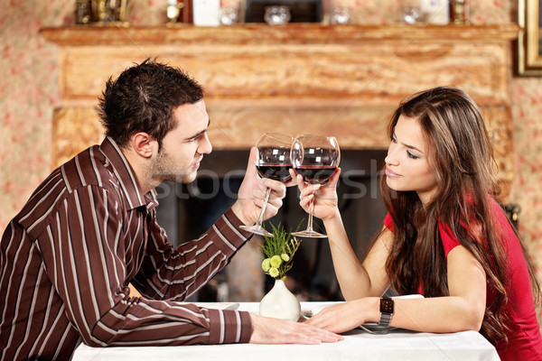 Couple cheers with wine Stock photo © imarin